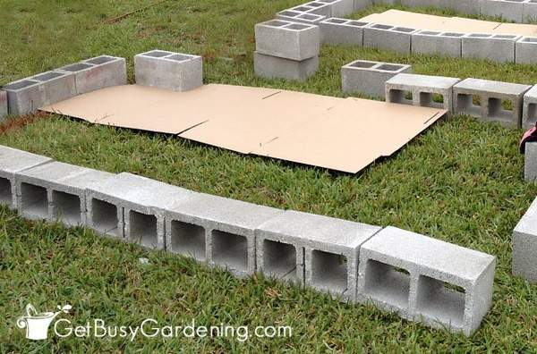 Laying cardboard under cinder block raised beds